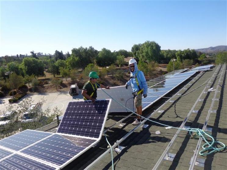 Why Natural Energy - solar panels on roof top